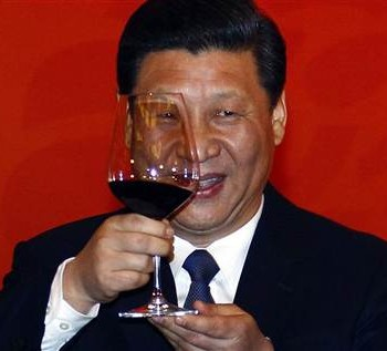 Chinese Vice-President Xi Jinping holds a glass of red wine