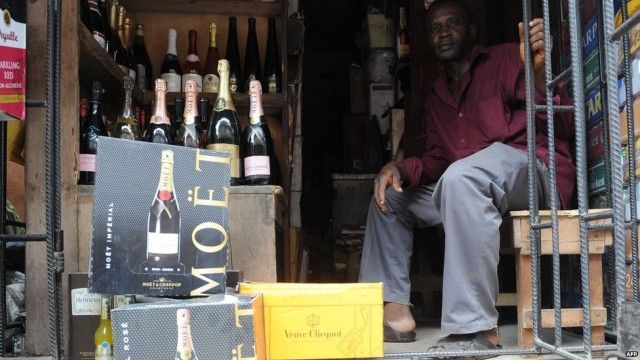 A vendor sells Champagne from a roadside shop in Lagos. Credit: APF