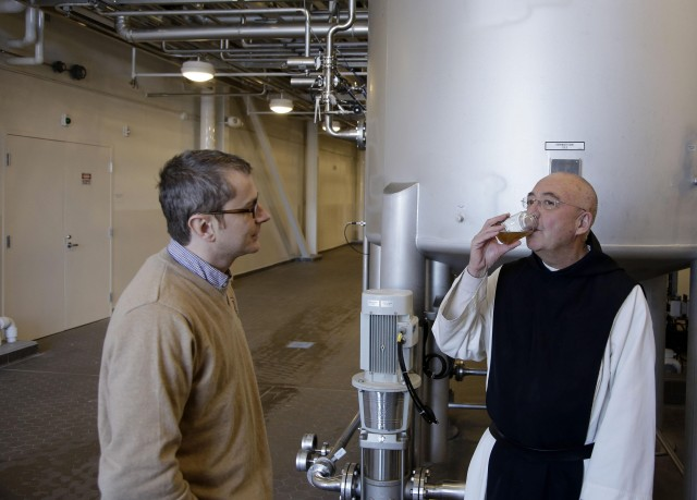 Spencer Brewery Director Father Isaac tastes a sample of Spencer ale wort, an early stage of fermentation, as Belgian brewing engineer Hubert de Halleux looks on at the Spencer Brewery in Spencer, Mass. Brewed by the Trappistine monks of St. Joseph's Abbey, Spencer Trappist Ale is the only certified Trappist beer brewed in the United States. (AP Photo/Stephan Savoia)