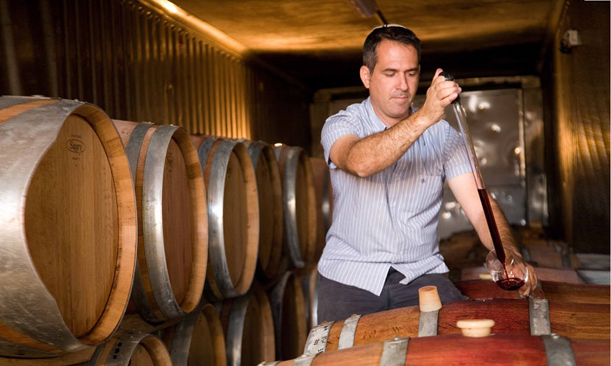Dr. Shivi Drori tests a sample of wine from Gvaot Boutique Winery. Photo courtesy of Gvaot Boutique Winery.