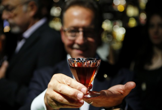 """Bar owner Salvatore Calabrese holds his """"Salvatore's Legacy"""" cocktail during his attempt to create the world's most expensive cocktail, in Mayfair central London"""
