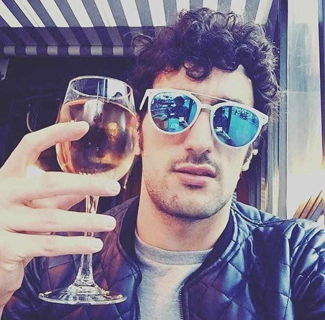 man drinking pink