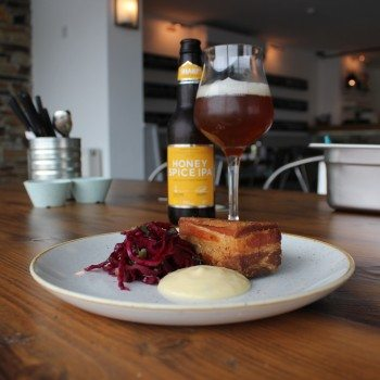 Honey Spice IPA with pork belly, potato terrine and pickled red cabbage