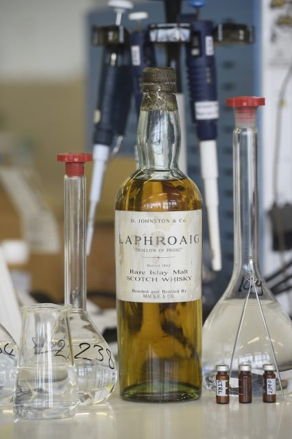 Pic Greg Macvean - 11/05/2016 - 07971 826 457 David Robertson and Andy Simpson, co-founders of Rare Whisky 101 open a 1903 bottle of Laphroaig to check it's authenticity at Scientific Services in Leven