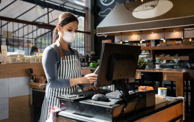 Waitress working in a mask