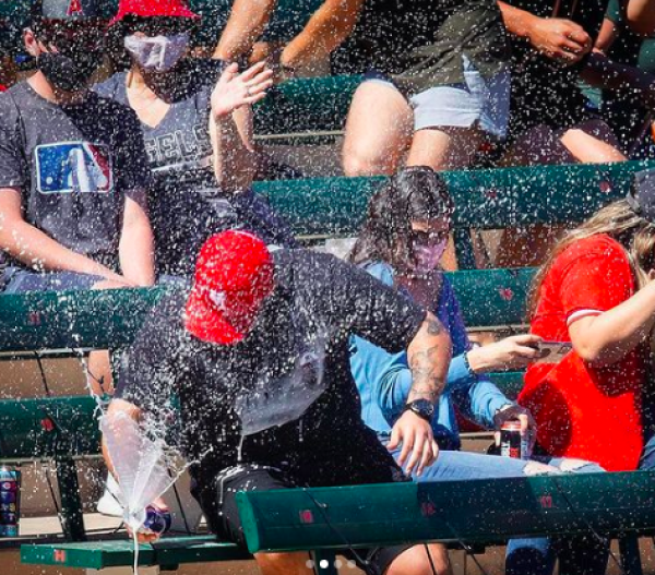 Man saves his date from being hit by a foul ball with his can of beer