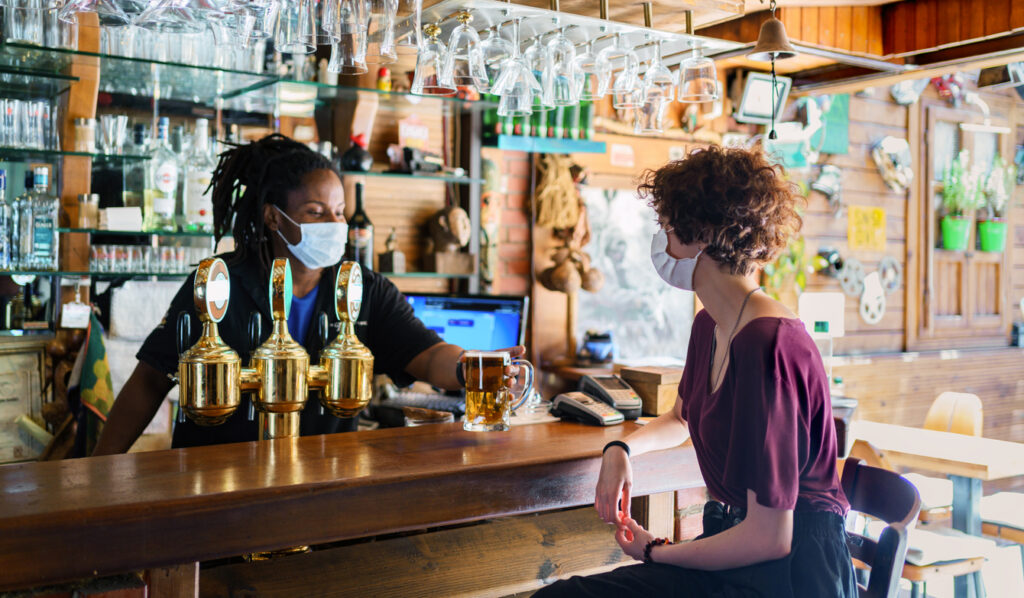 Vaccine passport: a beer being served in the pub