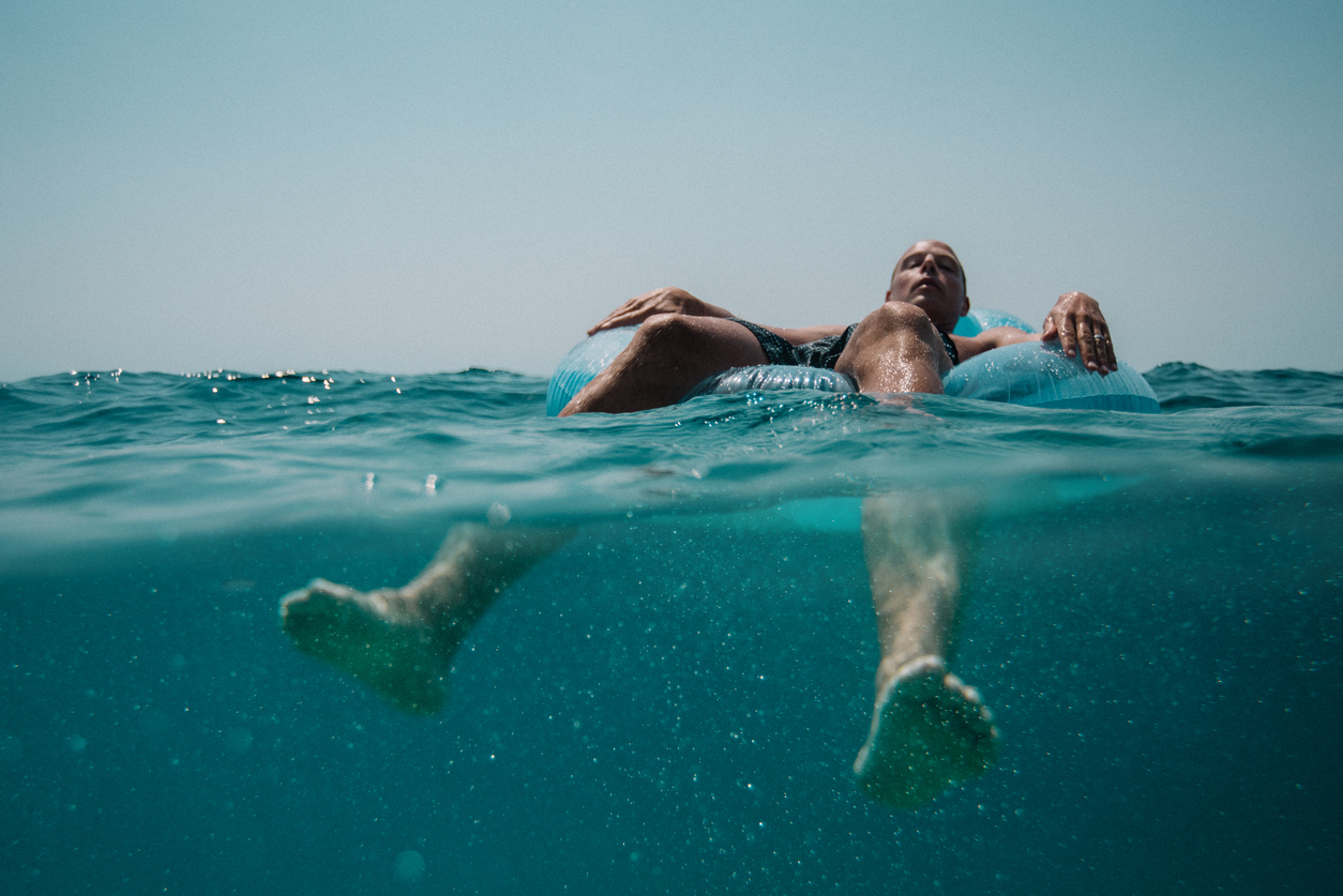 Man on inflatable in the sea