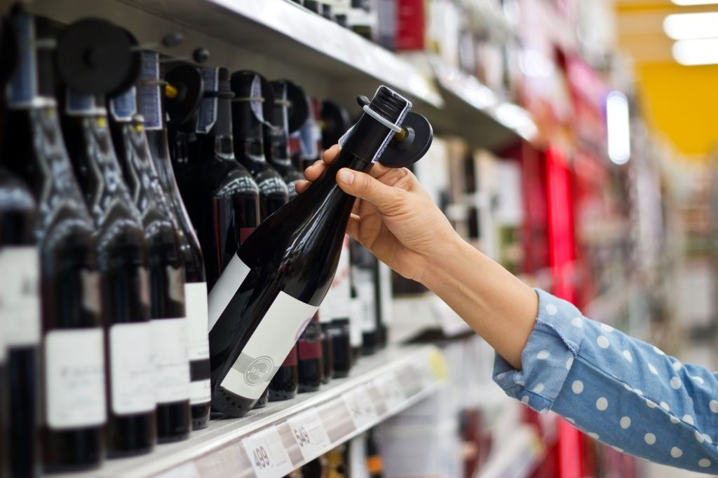 Woman buying wine: global wine consumption falls to lowest levels since 2002