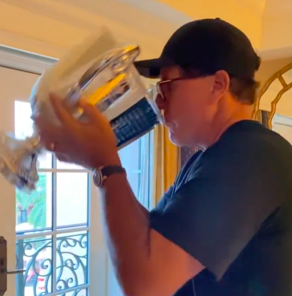 Phil Mickelson swigs from trophy