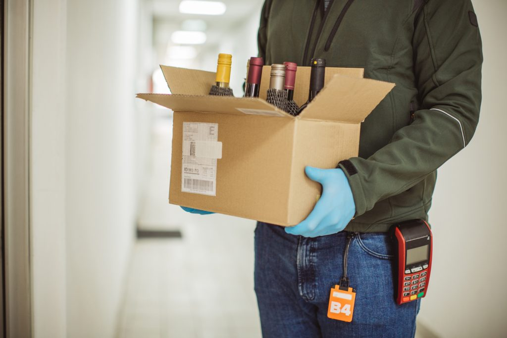Delivery Driver drops wine - box of wine bottles