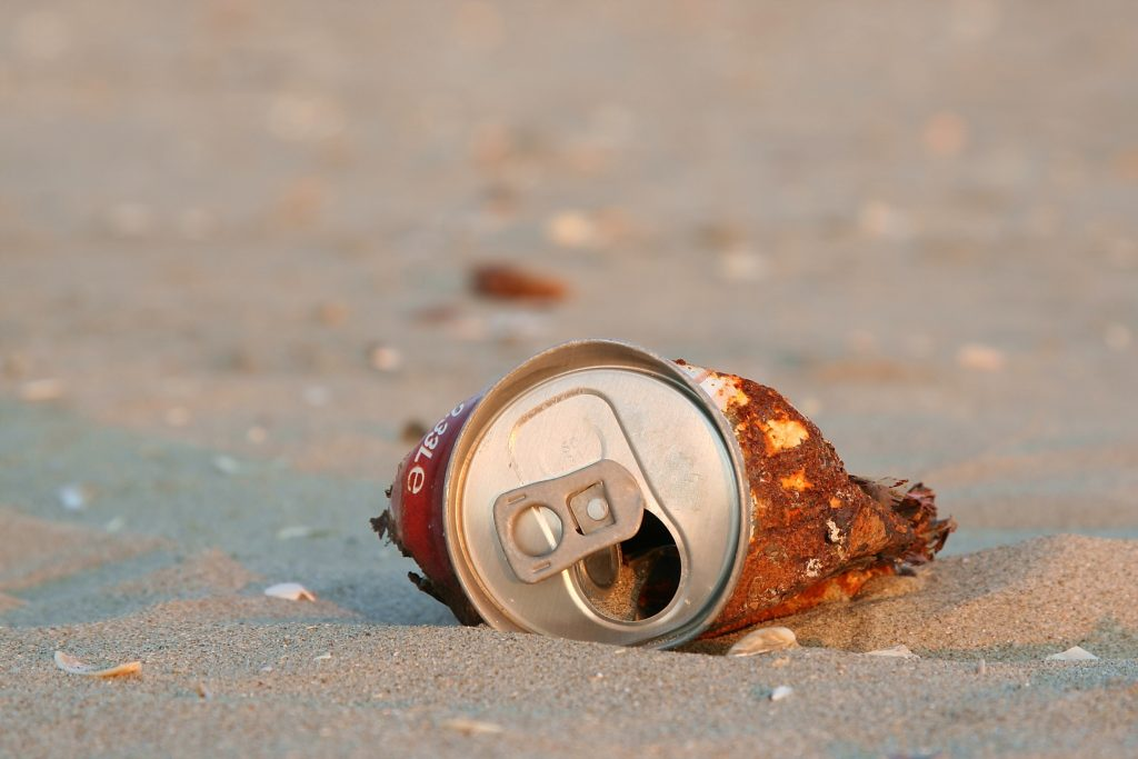 A can of beer on the beach - man finds 32-year-old cans of beer