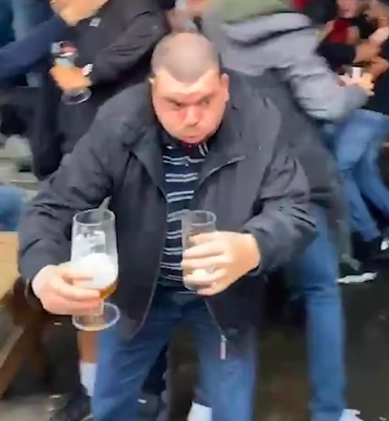 England fan heroically saves beer