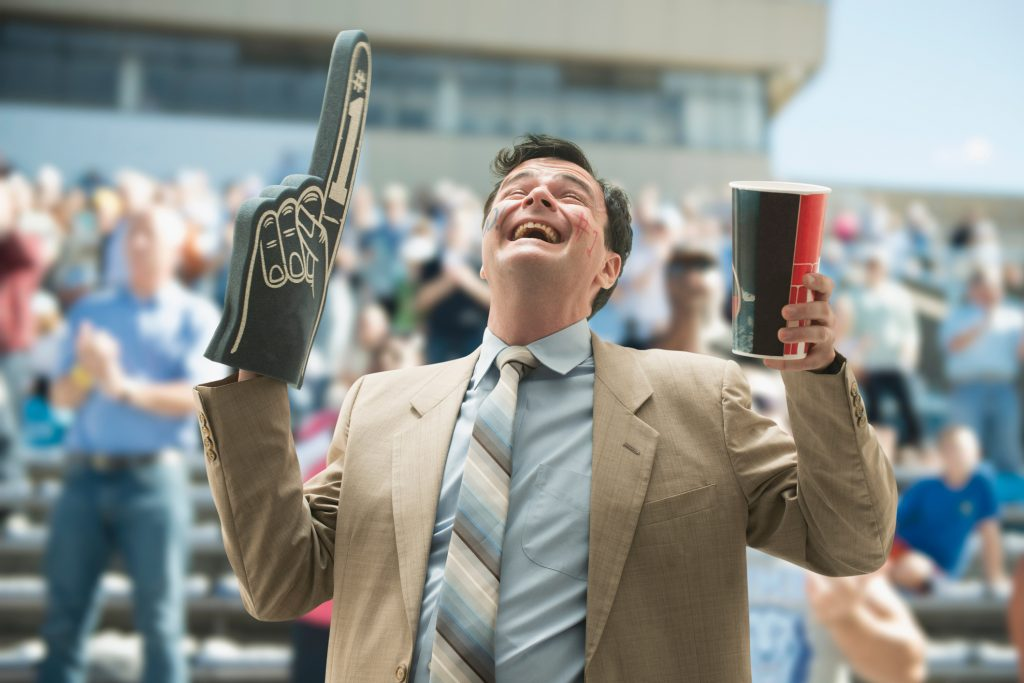The NFL teams with the drunkest fans: Man celebrates with foam hand in stadium