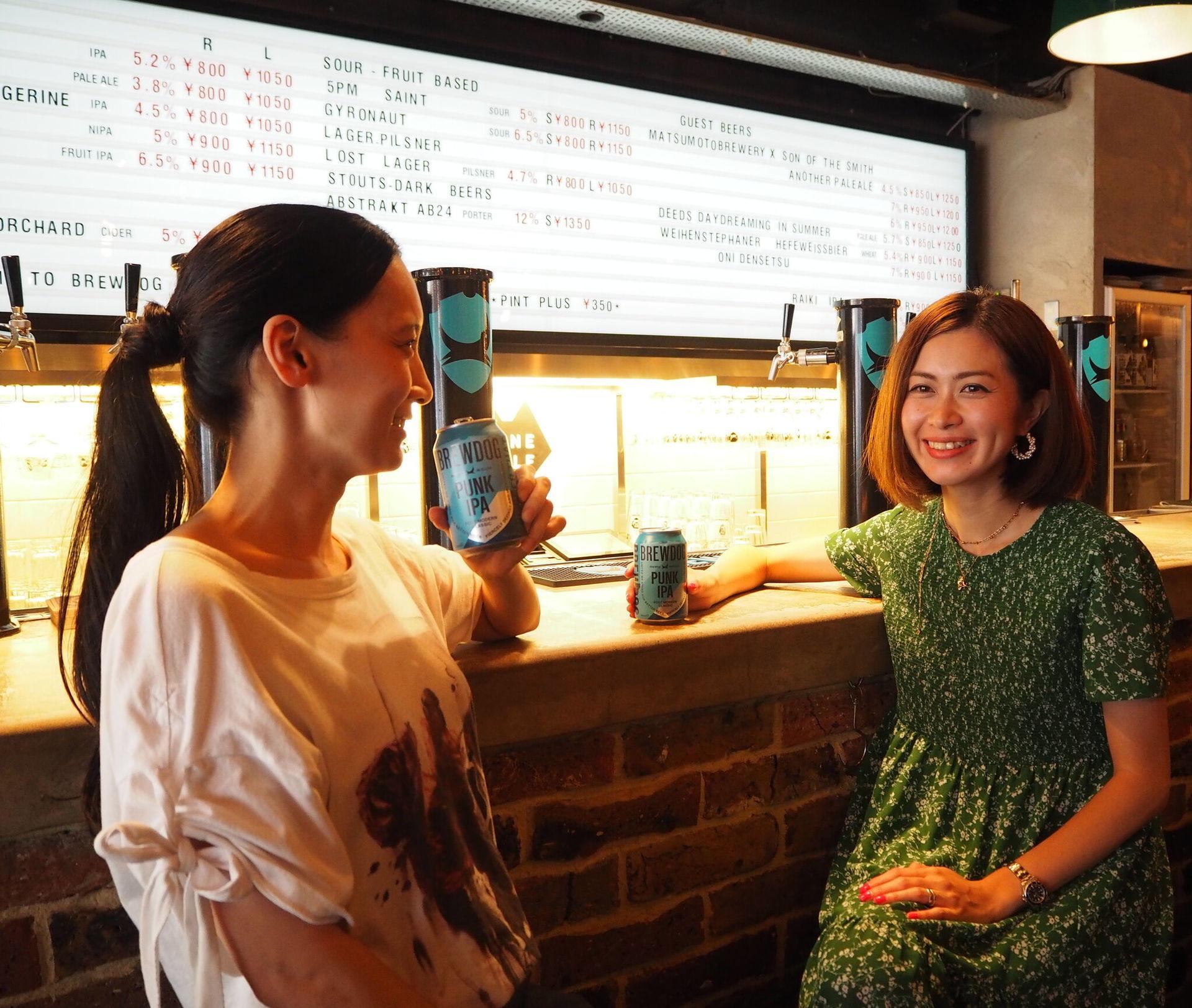 Two Japanese women enjoying a brewdog beer: BrewDog launches Japanese venture with the help of Asahi Japan