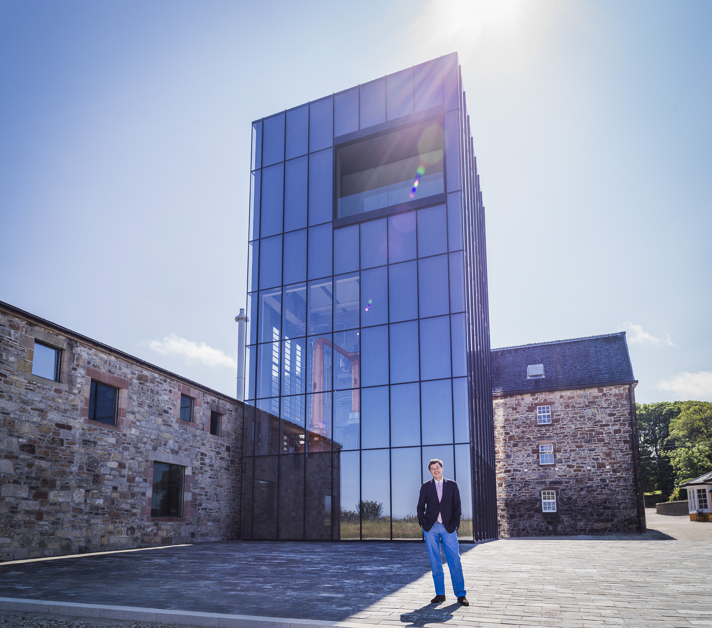 Bill Lumsden standing in front of Lighthouse distillery: Glenmorangie seeks innovation with new distillery