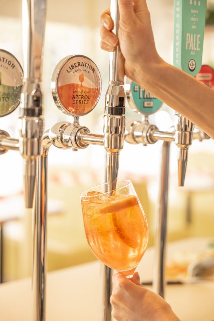 hand pouring an on-tap cocktail