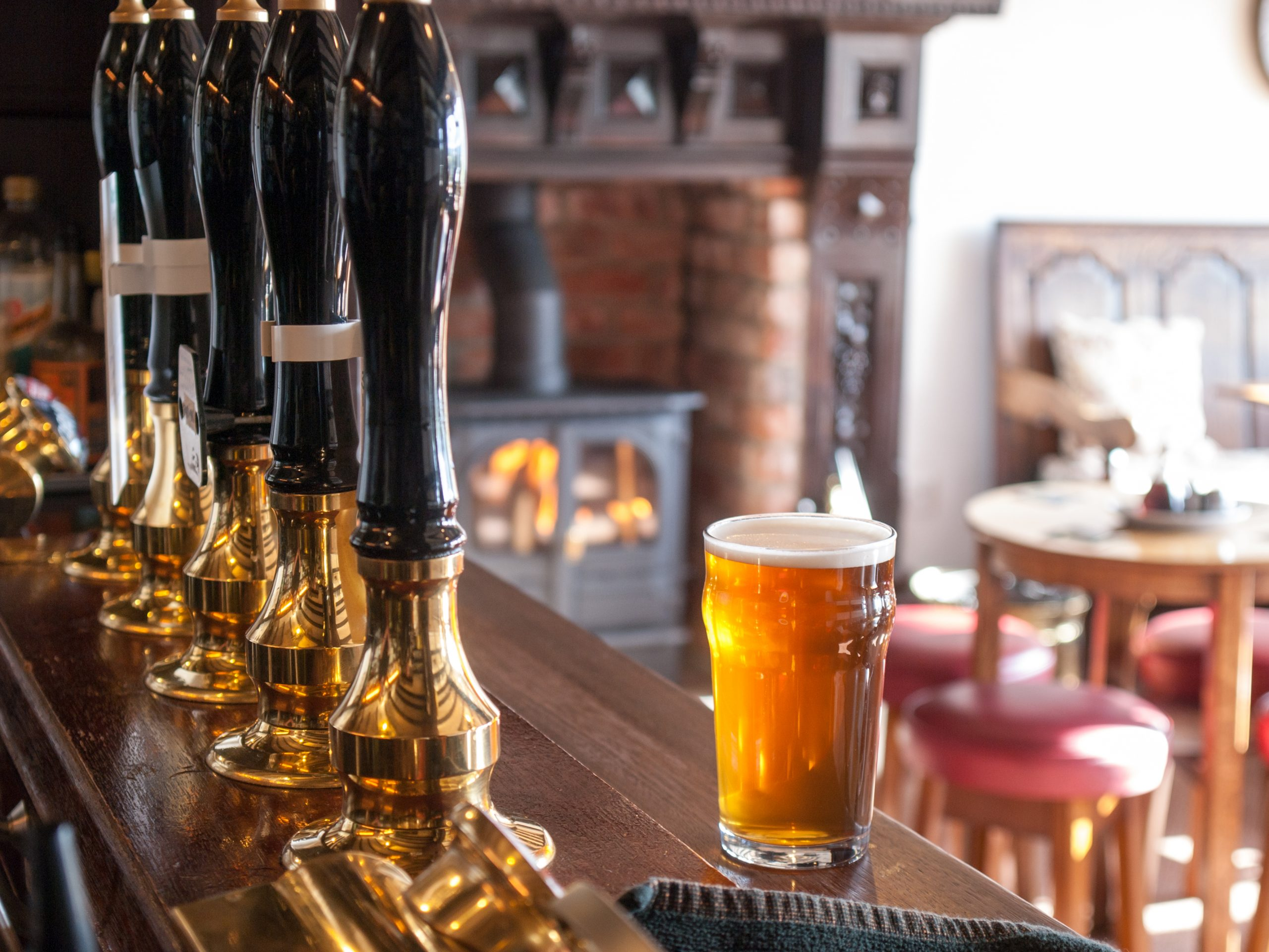 A view from behind an typical English pub bar: cask ale sales down by 76 million pints since pubs reopened