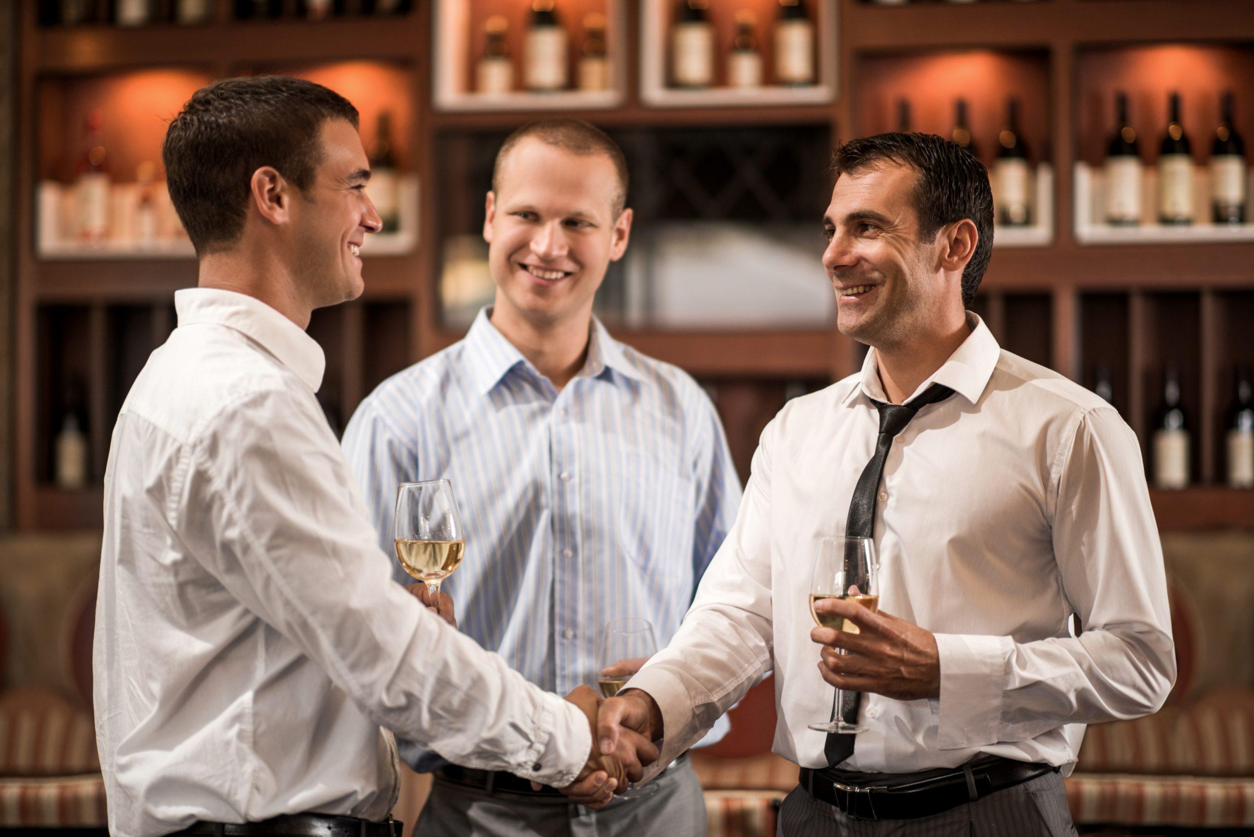 businessmen shaking hands: vinexposium boosts drinks trade with eventful season ahead