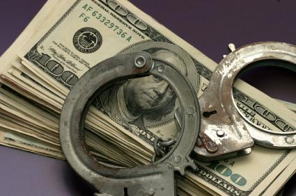 money-and-handcuffs-istock