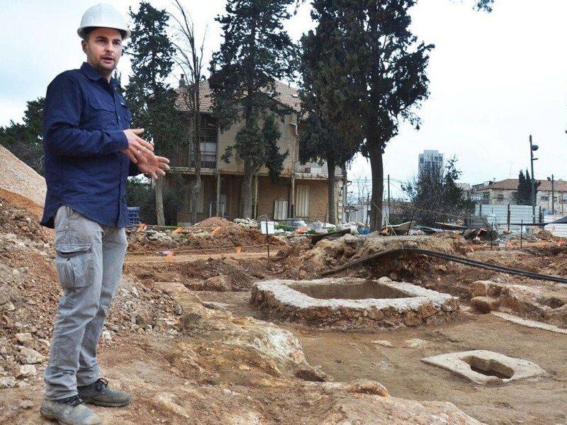 Alex Wiegmann, excavation director, views winepress uncovered in Schneller Compound