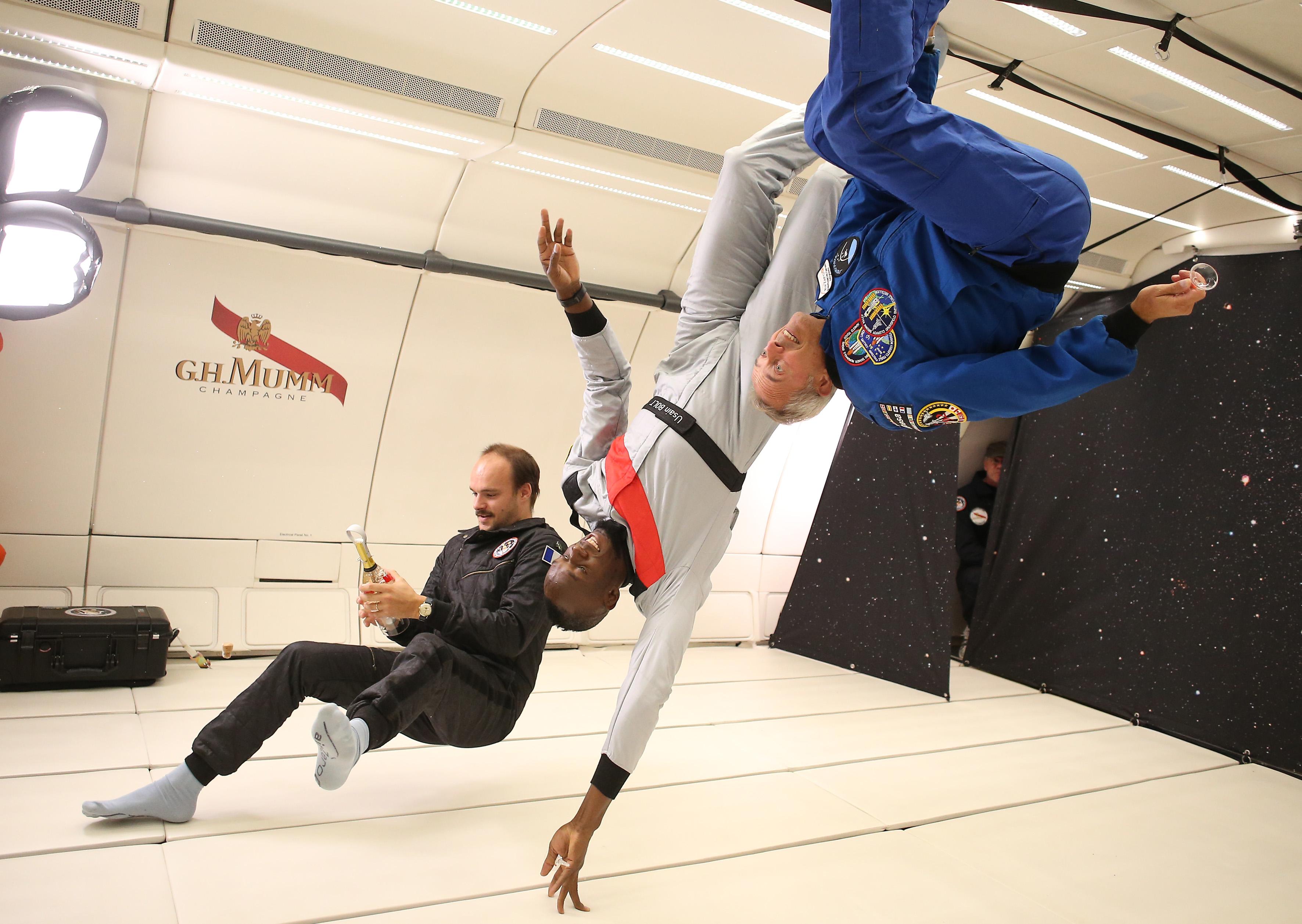 Usain Bolt tries Champagne Mumm's space Champagne in zero gravity