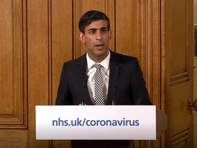 A photo of a spokesperson addressing the public on coronavirus