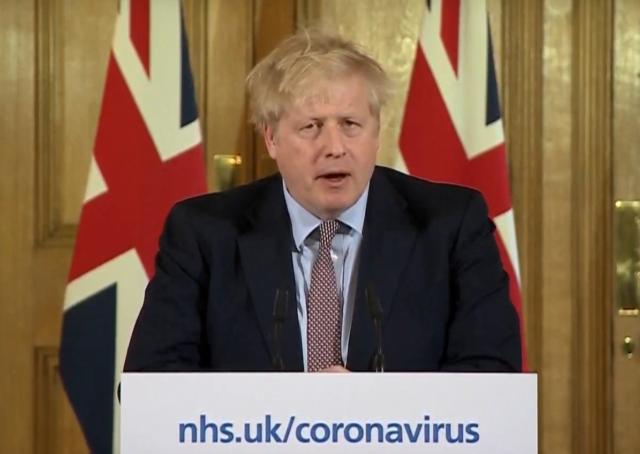 A photo of Boris Johnson addressing the public
